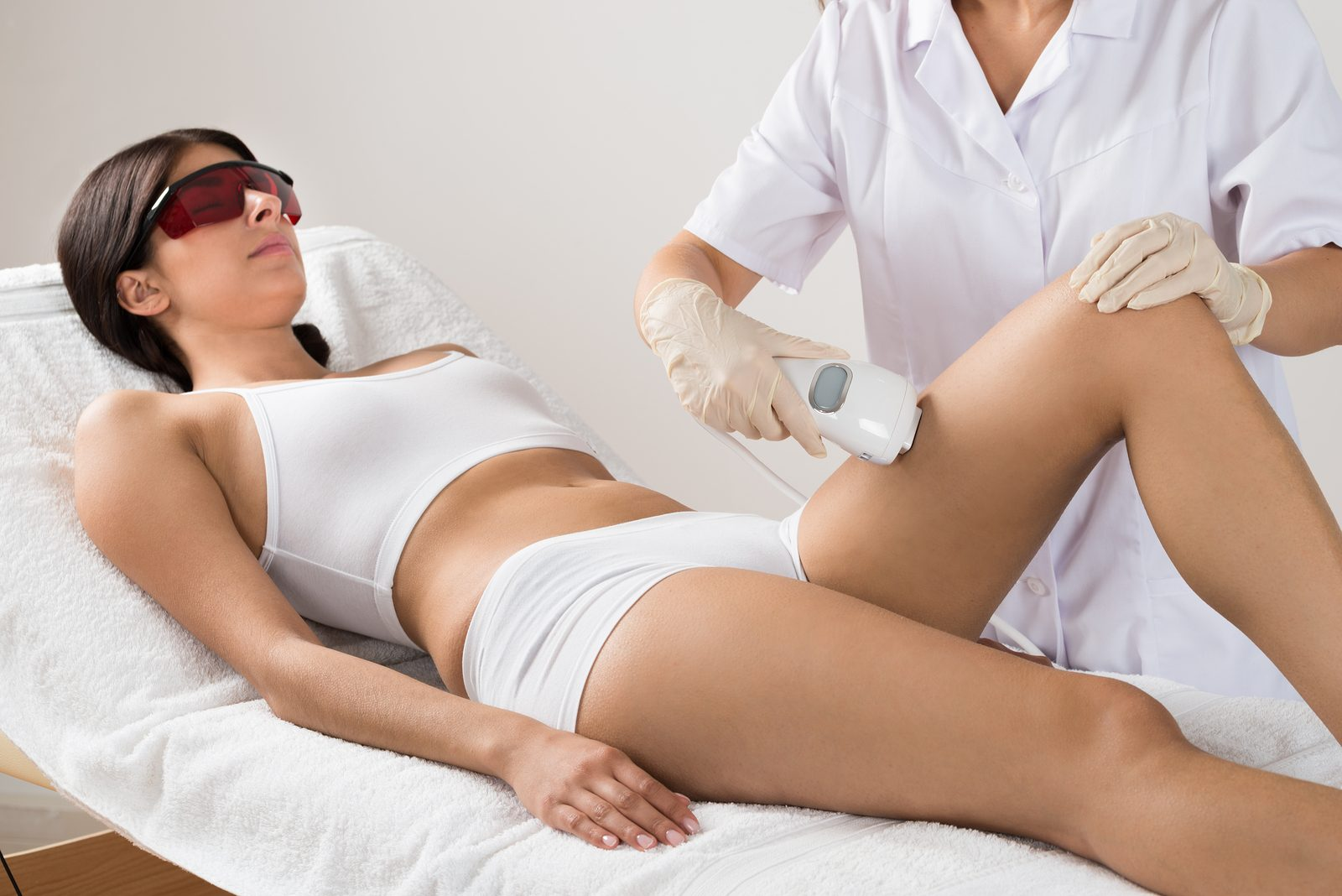 Bigstock Person Giving Laser Therapy To